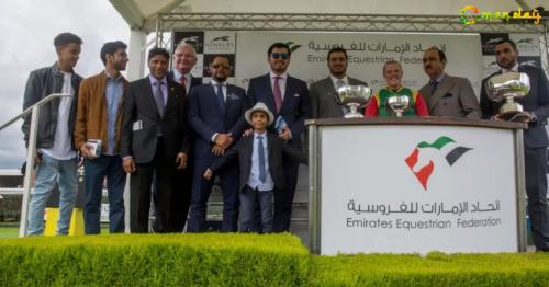 Representatives of Royal Cavalry of Oman pose with the trophies during the presentation ceremony. Photo - Supplied