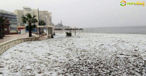 HOLIDAYMAKERS jetting to the Costa del Sol for some winter sun got a shock today - after finding some of its golden beaches covered in white.