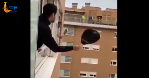 Coronavirus: Two quarantined Italian men play tennis across apartment windows.