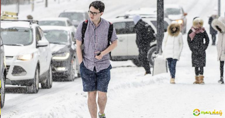 Student Goes Viral for Wearing 'Summer Clothes' in Winter Snow Storm